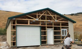 Day 3: Installed the Garage Door and cut the metal siding for the front face.